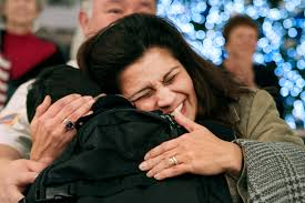 u s department of defense photo essay  a happy mother embraces her servicemember daughter at the baltimore washington international thurgood marshall airport