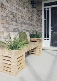 diy outdoor cedar bench with planters via shelterness