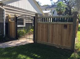 Custom wood privacy fence and scalloped aluminum gate designed and  installed by Mossy Oak Fence Company
