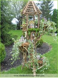 I have so much driftwood I should assemble a fairy tree house like this.  INSPIRATION!!!! Fairy tree house with ladder   trees and branches    Pinterest ...