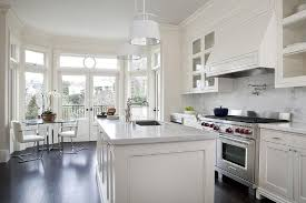 cream kitchen cabinets with white marble countertops