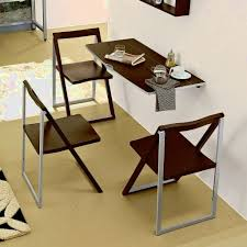 cream compact extending dining table: very small white dining table with two chairs and book storage