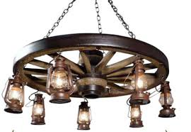 wagon wheel chandelier the wild west wagon wheel chandelier wagon wheel mason jar chandelier diy