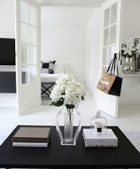 a coffee table with trays and decor