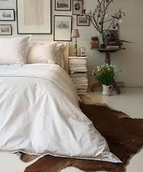 white white white bedroom turned cozy and welcoming with a brown cowhide rug