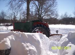 pics of snow rigs allischalmers forum page 1 all i have to plow snow is the wd45s and the old 610 bobcat