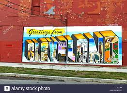 greetings from cleveland graffiti on the wall of ohio city near downtown cleveland ohio usa shows the landmarks and sports teams of the city  on cleveland sports teams wall art with greetings from cleveland graffiti on the wall of ohio city near