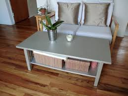 wooden coffee table painted with silver color with bookshelf and box storage for small living room spaces with wood loveseat sofa with leather cushions