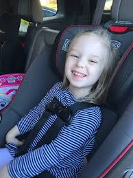 here is a picture of my daughter buckled into her car seat the same way but she is now wearing her winter coat