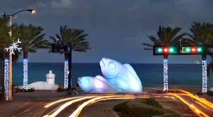 two giant illuminated fish on the beach holiday lights fort lauderdale style