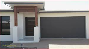 new client home with charcoal white and wood facade built in townsville australia