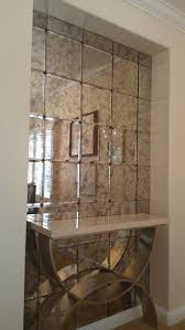antiqued mirror tiles with rosettes