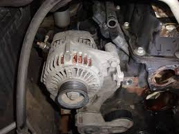 how to replace the timing chain on a wrangler tj 4 0 the step 8 remove the alternator bracket as the belt tensioner is attached to it and is blocking bolts on the timing chain cover the two bolts holding the