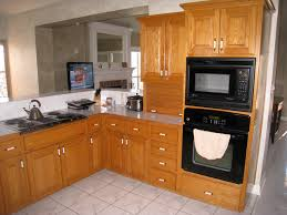 attractive grey dark granite countertops with oak cabinets with black kitchen appliances with drawers in white