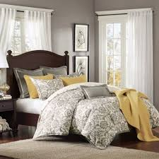full size gray bedding set with captivating yellow accent pillow