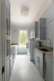laundry room furniture. long gray laundry room boasts a tension rod drying rack mounted to shaker cabinets fixed furniture