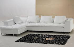 L Shaped White Leather Couch With Low Back And Arms Plus Cushions Also  Black Fluffy Rug
