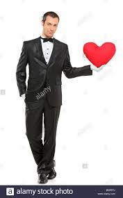 Man Shaped Pillow I Love You Man Holding A Red Heart Shaped Pillow Stock Photo