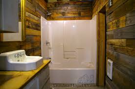 wood wall bathroom attractive covering walls with pallet the basement renovation regard to 14