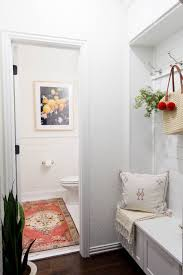 A bright and welcoming mudroom/powder room combo with a modern-casual-beach