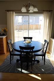 how to place a rug with round dining table within room rugs design 8