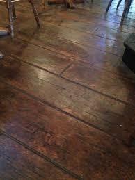 Stamped concrete floor made to look like barn wood floor.