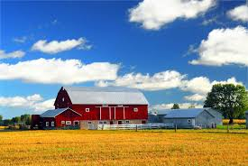 red barn in ontario is a sign that a farmers needs farm insurance
