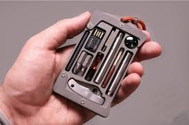 Create a wearable edc kit with dog tag bushcraft necklaces , grim workshop micro tool kits are keychain sized pieces of gear that create a mini urban or wilderness survival kit, tip cards and more Jackfish Survival Card Holder Clad