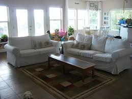 Living Room With Brown Leather Sofas Round Glass Coffee Table Metal Base Living Room Ideas