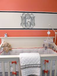 paint band accent striped wall with monogram over crib