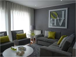 contemporary living room gray furniture microfiber l shape sectional sofa cushion white round end tables glass top green silk chevron throw pillow round
