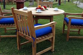 round wooden garden table and 4 chairs