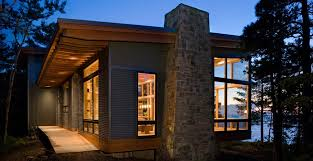 exterior building materials for house. roof overhangs provide sun and weather protection at the eagle harbor cabin. metal siding (re- cycled steel) is a maintenance-free exterior material. building materials for house .