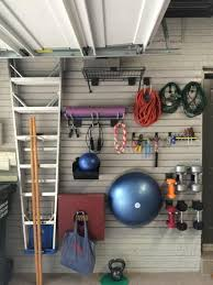 long for a workout space but lack spare room take advantage of garage wall to install everything you need stay in shape room storage ideas r80 storage