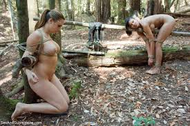 Two babes get tied up dominated and fucked outdoor in the woods.