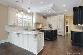 the elegant black island contrasts beautifully with the white custom cabinetry and stainless steel appliances