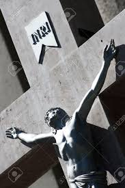 Detail of Jesus on cross in front of church with letters INRI above his head Stock