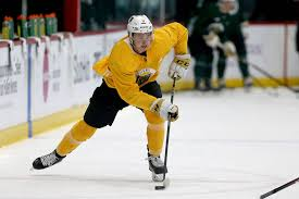 vegas golden knights forward cody glass 9 handles the puck during practice at city