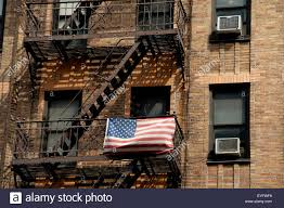 American Flag Outside An Apartments Building In Chelsea Manhattan - New york apartments outside
