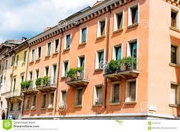Antique Windows Typical Orange Building With Antique Windows In Verona Stock Photo