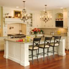 country western kitchen design with white wooden cabinet and ceramic backsplah plus marble top island with wooden base under black metal hanging lamp
