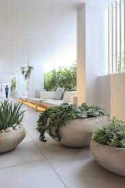 White and green contemporary modern planters with green succulents and  plants!
