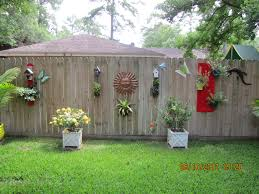 Decorating a plain wooden fence.