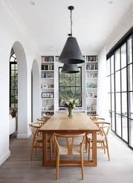 natural wood wishbone chairs dining room