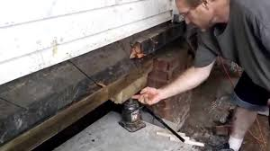 how to level a garage doorLeveling a House fix sinking Foundation Jacking Level Repair How