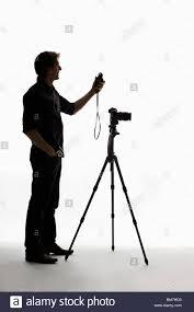 Using A Light Meter A Photographer Using A Light Meter Stock Photo 29670844 Alamy
