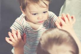 child looking in mirror. child looking in mirror