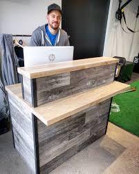 custom reclaimed barn board reception desk for thinkfitness studio in toronto
