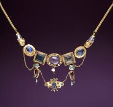 a polychromatic greek necklace with erfly pendant