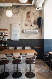 Industrial Style Bar With An Urban Mediterranian Fusion In